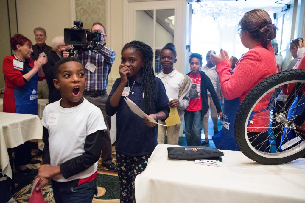 Deserving children surprised during presentation of bicycles at NFWL annual conference. Fire Power Seminars