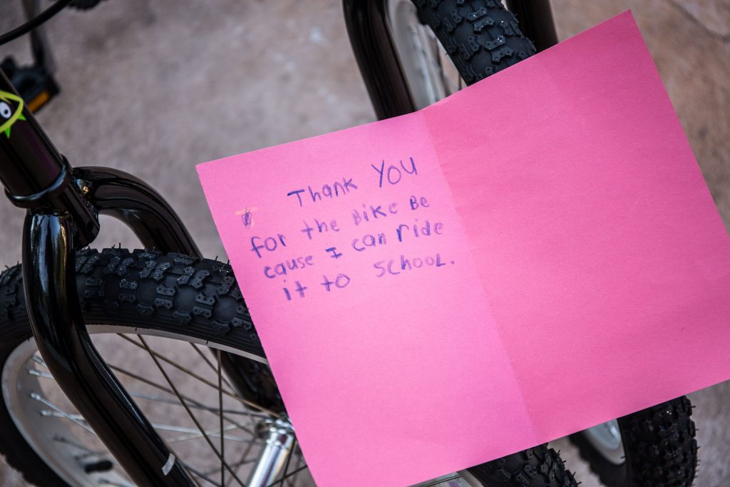 Corporate Social Responsibility (CSR) team-building activity bike building thank you card from deserving child who received a donated bike. Fire Power Seminars